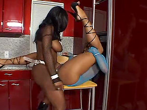 Jada Fire and Sydnee Capri fuck each other's beavers with fuck sticks in the kitchen