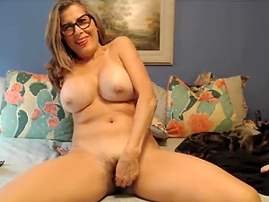 Latina milf shows her massive jugs for the camera and pleasures her pussy