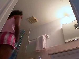 My girlfriend unware of the hidden camera in our bathroom.