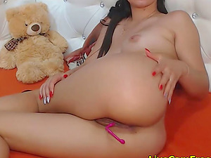 Sexy brunette teen has a toy in her shaved tight pussy