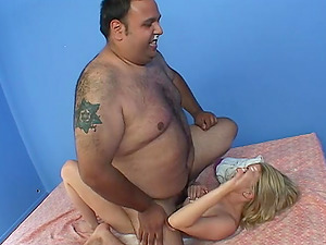 Blonde Tiffany Rose pleases a fat guy by sucking his dick