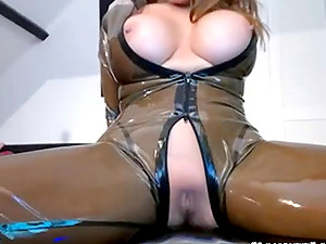 Brunette in sexy leather lingerie opens her legs wide to show her cunt