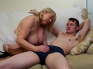 Young guy likes it when mature hottie Auntie Trisha plays with his dick