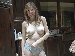 Good looking Gwen slowly undresses so she can pose nude