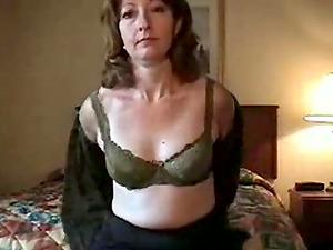 Hot milf strips off her underwear then masturbates