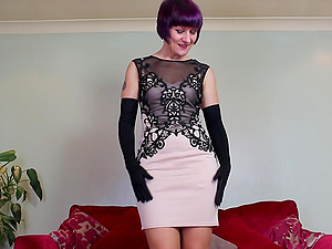 Purple haired amateur mature British MILF fingers herself