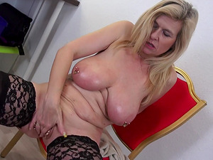Busty mature blonde MILF Marina Montana fingers her pierced pussy