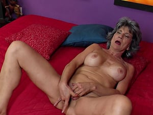 Grey haired mature granny Raquelle fingers her hairy pussy