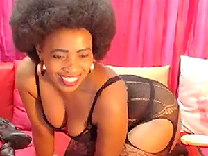 Ebony mature with an Afro strips, twerks and bates on cam