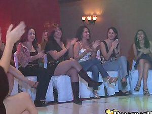 Group of horny ladies witnesses at the fellow performing striptease
