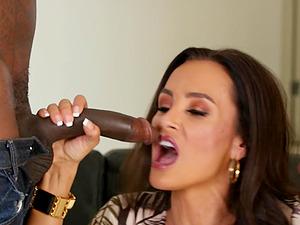 Interracial threesome with Lisa Ann handling two black cocks