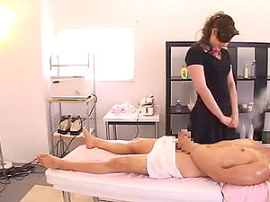 Hot Japanese chick gives a rubdown and gets fucked