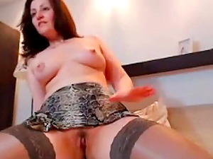 Russian babe in snake skin fucking her pussy.