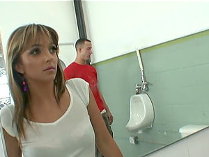Lexi Love gets her fuckholes drilled in the public restroom in threesome MMF clip