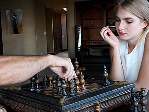 Blue eyed amateur blonde babe Angelina plays chess in a dress