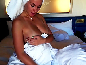 Brunette girl with tanning lines toying her sweet pussy to orgasm