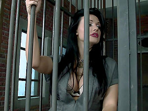 Amazing dark haired damsel in office clothes gets pounded in a jail