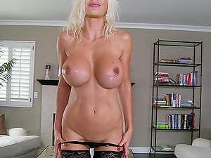 Lewd blonde Puma Swede plays with her vulva in the living room