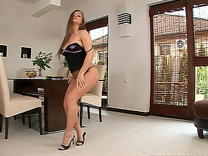Rita Faltoyano strips and plays with her meaty snatch