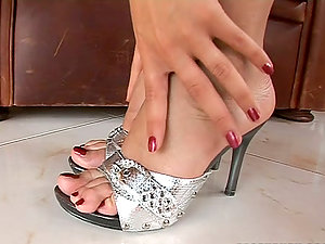 Dark-haired Touches Her Oiled Up Feet On A Dude's Hard Hard-on