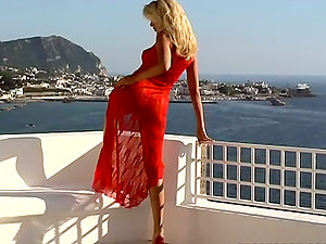 Sophie Moone plays with her nice snatch on the balcony