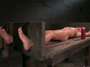 Cecilia Vega gets covered with hot paraffin wax and drilled with a machine