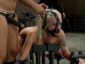 Spanked and bonded blonde dame gets fucked in her mouth