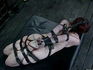 Desirable red-haired gets ball-gagged and bondaged