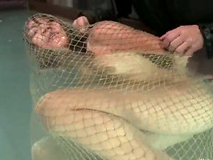 Keeani Lei gets packaged in the net and thrown in the water