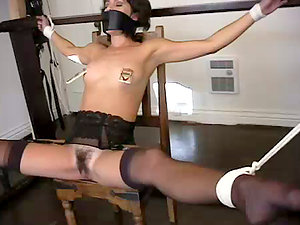 Universal handcuffs hold her gams and arms together