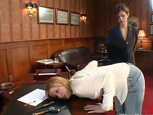 Blonde chick gets disciplined by a brown-haired in an office