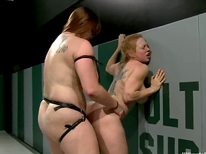Fat bitch bangs her enemy with a gigantic strapon