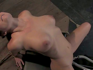 Holly West gets drilled by a machine in restrain bondage