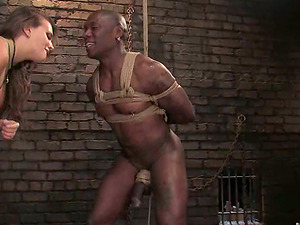 Big-boobed dame ties up Black man and fucktoys him with a strapon