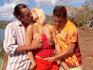 Diana Gold deep-throats two sausages and gets dual penetrated outdoors
