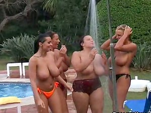 Four chicks with giant jugs swim in a pool and take a bathroom