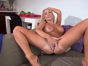 Tasha Reign boasts of her beautiful tits and thumbs her nice labia