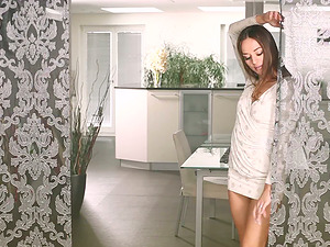 Long-haired Dominika C strips and shows her big beaver lips