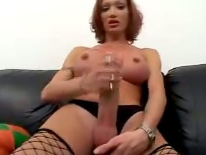 Tranny in Fishnet Stockings Jerking Off Her Big Dick