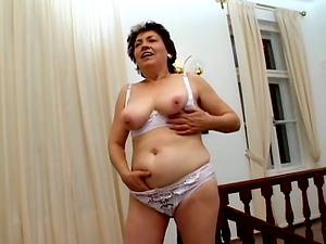 Filthy grandma gets naked and staffs her vagina with a banana