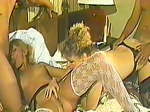 Two retro chicks in stockings get pounded by two fellows