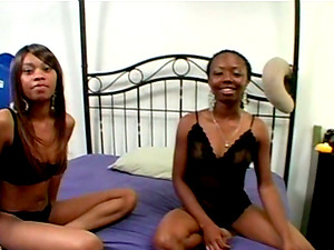 Two slender black gals suck a dick in interracial threesome vid