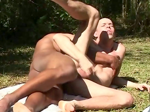 Bald poofter likes leaping on his black mate's penis in the yard