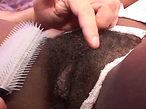 Black bitch gets her hairy cunt combed and fucked in all positions