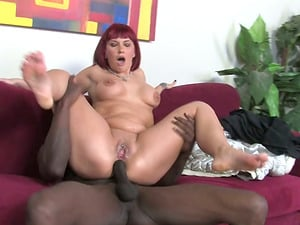 Delicious red-haired siren Carrie Ann is going to go for black