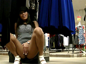 Asian style female is masturbating in the store
