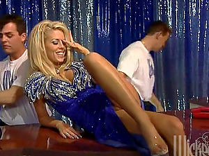 A smoking hot blondie siren is getting fucked by two
