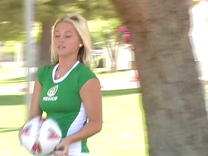 Alison Angel poses in sexy soccer clothing in a park