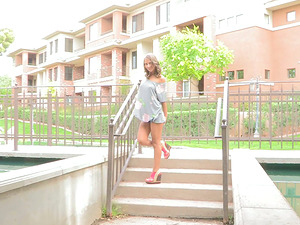 Presley touches tits and shows her gams in hte street