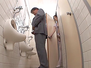 Sayoko blows a dude in a public restroom